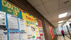 COVID-19 safety information is posted on the wall of Yorkwoods Public School, in Toronto, Ont., on Wednesday, Aug., 26, 2020. THE CANADIAN PRESS/Christopher Katsarov