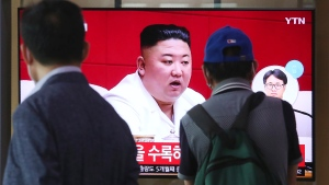"People watch a screen showing a file image of North Korean leader Kim Jong Un during a news program at the Seoul Railway Station in Seoul, South Korea, Friday, Sept. 25, 2020. Kim apologized Friday over the killing of a South Korea official near the rivals' disputed sea boundary, saying he's ""very sorry"" about the ""unexpected"" and ""unfortunate"" incident, South Korean officials said Friday. (AP Photo/Ahn Young-joon)"