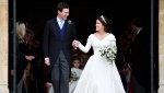 FILE - In this Friday, Oct. 12, 2018 file photo, Britain's Princess Eugenie and Jack Brooksbank leave St George's Chapel after their wedding at Windsor Castle, in Windsor, England. Princess Eugenie and her husband Jack Brooksbank annouced on Friday, Sept. 25, 2020, they are expecting their first baby in early 2021. (Toby Melville, Pool via AP, File)