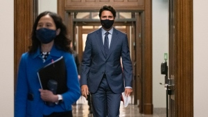 Prime Minister Justin Trudeau arrives with Chief Public Health Officer of Canada Dr. Theresa Tam, left, for a news conference on the COVID-19 pandemic on Parliament Hill in Ottawa, on Friday, Sept. 25, 2020. THE CANADIAN PRESS/Justin Tang