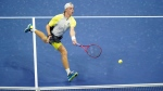 Denis Shapovalov, of Canada, returns to Pablo Carreno Busta, of Spain, during the quarterfinal round of the US Open tennis championships, Tuesday, Sept. 8, 2020, in New York. THE CANADIAN PRESS/AP, Frank Franklin II