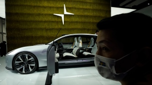 A Polestar Precept concept car that was announced to go into production is displayed at the Auto China 2020 show in Beijing on Saturday, Sept. 26, 2020. Ford, Nissan and BMW unveiled electric models with more range for China on Saturday as the Beijing auto show opened under anti-virus controls that included holding news conferences by international video link. (AP Photo/Ng Han Guan)