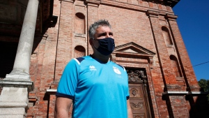 Mattia Maestri answers reporters' questions prior to the start of a 180-kilometer relay race, in Codogno, Italy, Saturday, Sept. 26, 2020. Italy's coronavirus Patient No. 1, whose case confirmed one of the world's deadliest outbreaks was underway, is taking part in a 180-kilometer relay race as a sign of hope for COVID victims after he himself recovered from weeks in intensive care. (AP Photo/Antonio Calanni)