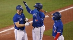 Toronto Blue Jays Randal Grichuk ,left, celebrates his three-run home run with Vladimir Guerrero Jr., center, and Teoscar Hernandez during the seventh inning of the team's baseball game against the Baltimore Orioles, Saturday, Sept. 26, 2020, in Buffalo, N.Y. (AP Photo/Jeffrey T. Barnes)