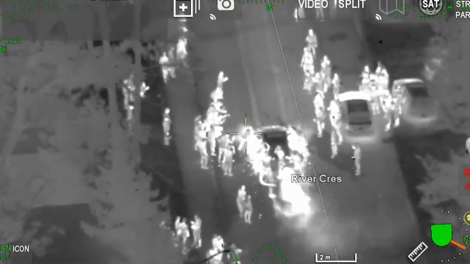 An aerial video shows stunt driving during a car takeover in Wasaga Beach. (OPP/Twitter)