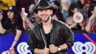 "Brett Kissel arrives on the red carpet at the iHeartRadio MMVAs in Toronto on Sunday, Aug. 26, 2018. Brett Kissel wins album of the year for ""Now or Never"" at the Canadian Country Music Association Awards. THE CANADIAN PRESS/Frank Gunn"