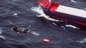 File- In this Sept.28, 1994 file photo, Swedish Marine rescue helicopter flies over the life rafts from the Estonian ferry 'Estonia', that capsized and sank in the Baltic Sea. A Paris court rejected a compensation claim Friday related to the 1994 sinking of an Estonian ferry, which remains one of Europe's deadliest maritime disasters. (AP Photo/Esa Pyysalo, File)