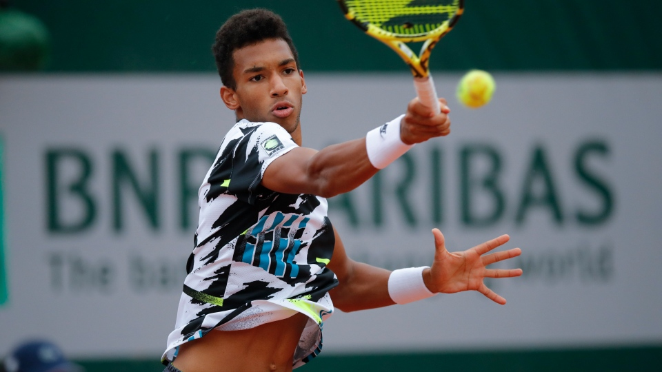 Canada's Felix Auger-Aliassime plays a shot against Japan's Yoshihito Nishioka in the first round match of the French Open tennis tournament at the Roland Garros stadium in Paris, France, Monday, Sept. 28, 2020. (AP Photo/Christophe Ena)