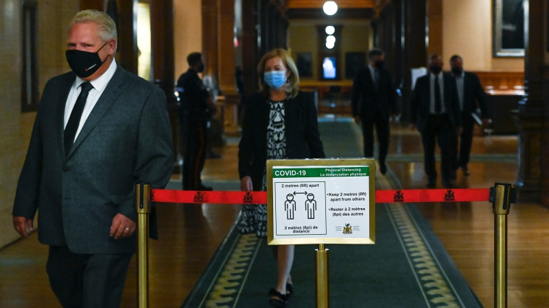 Ontario Premier Doug Ford, followed by Health Minister Christine Elliott, arrives for a news conference at Queen's Park during the COVID-19 pandemic in Toronto on Monday, September 28, 2020. THE CANADIAN PRESS/Nathan Denette