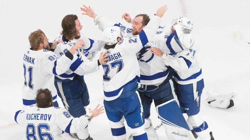 Tampa Bay Lightning players celebrate after defeating the Dallas Stars to win the Stanley Cup in Edmonton on Monday, September 28, 2020. THE CANADIAN PRESS/Jason Franson