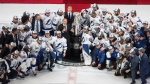 Tampa Bay Lightning players surround NHL Commissioner Gary Bettman as they celebrate after defeating the Dallas Stars to win the Stanley Cup in Edmonton on Monday, September 28, 2020. THE CANADIAN PRESS/Jason Franson