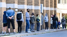 COVID assessment centre, line up