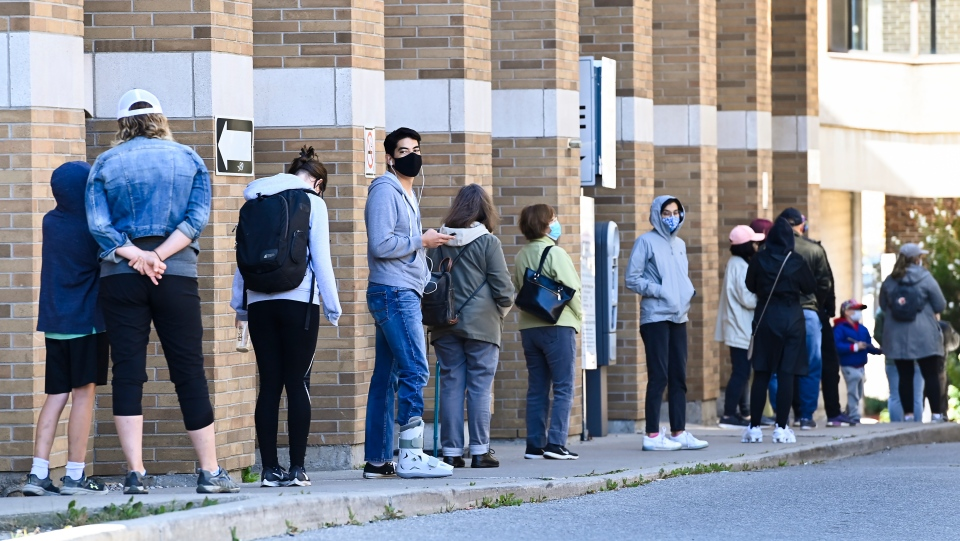 People line up at a COVID assessment centre during the COVID-19 pandemic in Toronto on Friday, September 18, 2020. Ontario is reporting 401 new cases of COVID-19 today, a daily increase not seen since early June. THE CANADIAN PRESS/Nathan Denette