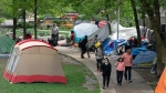 Pedestrians make their way through the tent encampent at Sanctuary Toronto on Friday May 29, 2020. THE CANADIAN PRESS/Frank Gunn