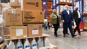 Ontario Premier Doug Ford, centre, tours a warehouse where they ship personal protective equipment during the COVID-19 pandemic in Milton, Ont., on Wednesday, September 30, 2020. THE CANADIAN PRESS/Nathan Denette