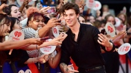 Shawn Mendes takes photos with fans as he arrives on the red carpet at the iHeartRadio MMVAs in Toronto on August 26, 2018. THE CANADIAN PRESS/Frank Gunn