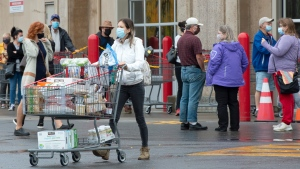 Shoppers stock up at a Costco store Wednesday, September 30, 2020 in Boisbriand, Que.. The Quebec government is upgrading the COVID-19 alert level to red in the Montreal area as of midnight.THE CANADIAN PRESS/Ryan Remiorz
