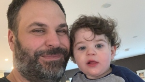 Terry Pirovolakis and his two-year-old son Michael pose in this undated handout photo. The father of a young Ontario boy with a rare genetic disease is asking the federal government to help fund research that could treat his child's condition. Terry Pirovolakis says his two-year-old son Michael was diagnosed last year with SPG50, an extremely rare disorder that causes a loss of mobility and a decline in brain functions over time. THE CANADIAN PRESS/HO - Terry Pirovolakis