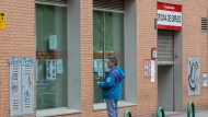 FILE - In this Tuesday, April 28, 2020 file photo, a man looks at notices on the window of an unemployment office in Madrid, Spain. (AP Photo/Paul White, File)