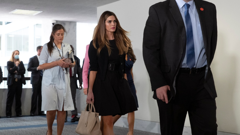 Counselor to the President Hope Hicks, center, walks in the Hart Senate Office Building on Capitol Hill in Washington before a meeting with President Donald Trump and Republican Senators at their weekly luncheon, Tuesday, May 19, 2020. (AP Photo/Patrick Semansky)