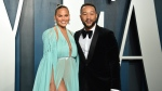 "FILE - This Feb. 9, 2020 file photo, Chrissy Teigen, left, and John Legend arrive at the Vanity Fair Oscar Party in Beverly Hills, Calif. Teigen and Legend have revealed the ""deep pain"" they are feeling, over the loss of their unborn baby following pregnancy complications. Teigen announced their loss on her social media accounts early Thursday, Sept. 30, saying they were ""driving home from the hospital with no baby. This is unreal."" (Photo by Evan Agostini/Invision/AP, File)"