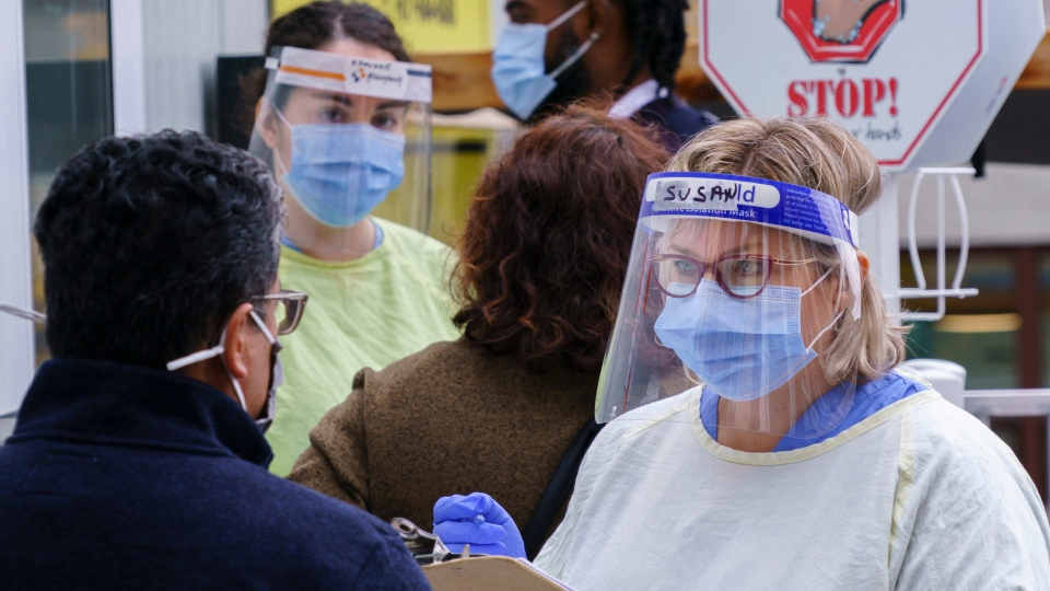Nurses greet patients at a COVID-19 walk-in clinic in Montreal, on Tuesday, Sept. 29, 2020. (THE CANADIAN PRESS / Paul Chiasson)