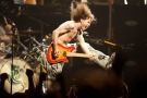"""In this June 22, 2004, file photo, Eddie Van Halen plays the final chord of """"Jump"""" during the Van Halen concert at the Continental Airlines Arena in East Rutherford, N,.J. Eddie Van Halen, the guitar virtuoso whose blinding speed, control and innovation propelled his band Van Halen into one of hard rock's biggest groups, died Tuesday, Oct. 6, 2020. Van Halen, who had battled cancer, was 65. (John Munson/NJ Advance Media via AP)"""