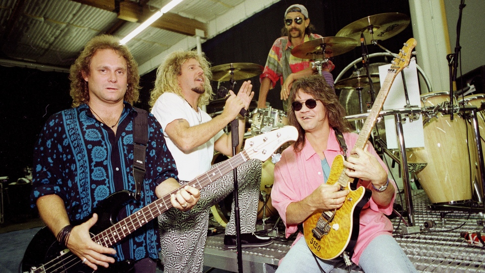 Van Halen is seen in Los Angeles, Jan. 17, 1993. Members of Van Halen, from left, left, Michael Anthony, bass guitar, Sammy Hagar, lead singer, Alex Van Halen, drums, and Eddie Van Halen, lead guitar appear in Los Angeles on Jan. 17, 1993. Eddie Van Halen, who had battled cancer, died Tuesday, Oct. 6, 2020. He was 65. (AP Photo/Kevork Djansezian, File)