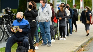 People line up at a COVID-19 assessment centre by appointment only at the Michael Garron Hospital during the COVID-19 pandemic in Toronto on Thursday, October 8, 2020. THE CANADIAN PRESS/Nathan Denette