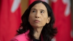 Chief Public Health Officer Theresa Tam looks at a slide projected on a screen during a news conference Friday October 9, 2020 in Ottawa. THE CANADIAN PRESS/Adrian Wyld