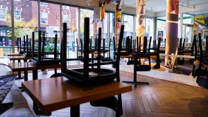 Chairs are stored at a pizza restaurant in Montreal, on Wednesday, September 30, 2020. Bars, restaurant and dining rooms in red zones in Quebec will close at midnight for 28 days as of midnight Wednesday. (Photo: THE CANADIAN PRESS/Paul Chiasson)