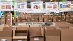 Boxes wait to be filled with provisions at The Daily Bread Food Bank warehouse in Toronto on Wednesday March 18, 2020. THE CANADIAN PRESS/Chris Young