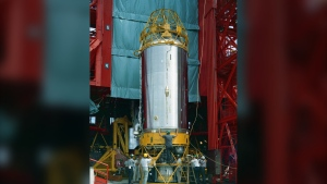 In this Aug. 13, 1965 photo provided by the San Diego Air and Space Museum, technicians work on an Atlas Centaur 7 rocket at Cape Canaveral, Fla. NASA's leading asteroid expert, Paul Chodas, speculates that asteroid 2020 SO, as it is formally known, is actually a Centaur upper rocket stage that propelled NASA's Surveyor 2 lander to the moon in 1966 before it was discarded. (Convair/General Dynamics Astronautics Atlas Negative Collection/San Diego Air and Space Museum via AP)
