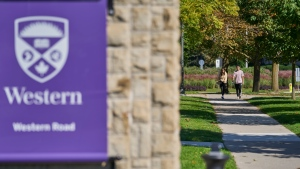 Students walk across campus at Western University in London, Ont., Saturday, Sept. 19, 2020. THE CANADIAN PRESS/Geoff Robins