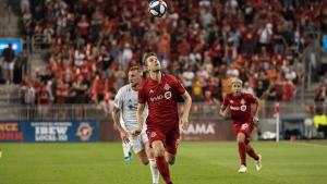 Toronto FC forward Patrick Mullins (13) keeps his eye on the ball during second half MLS soccer action against FC Cincinnati, in Toronto, Saturday, July 27, 2019. THE CANADIAN PRESS/Christopher Katsarov