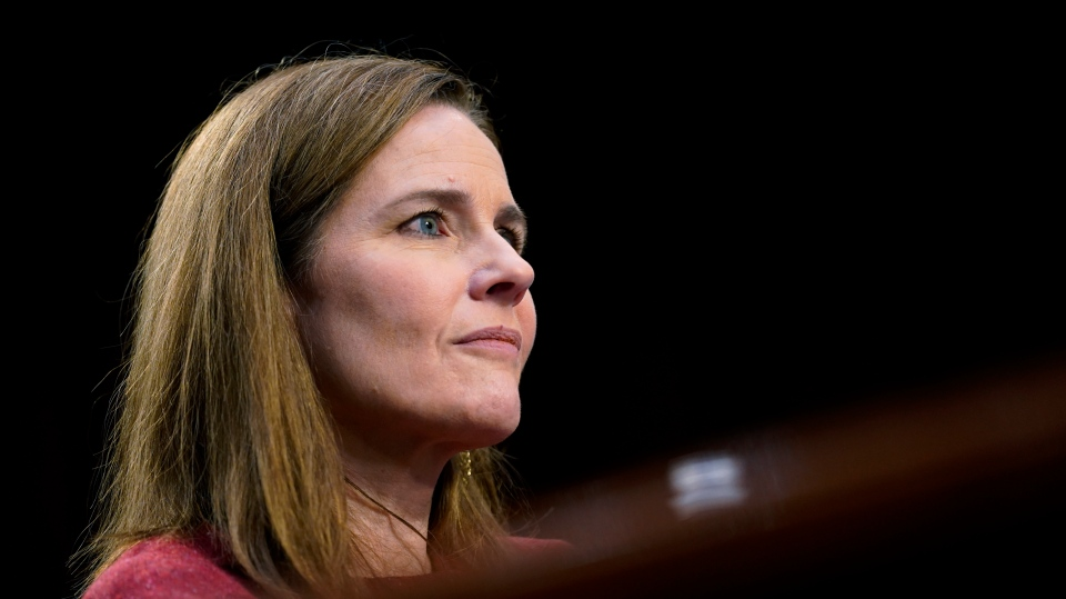 Supreme Court nominee Amy Coney Barrett listens during a confirmation hearing before the Senate Judiciary Committee, Tuesday, Oct. 13, 2020, on Capitol Hill in Washington. (AP Photo/Patrick Semansky, Pool)