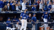 Toronto Blue Jays Jose Bautista flips his bat after hitting a three-run homer during seventh inning game 5 American League Division Series baseball action in Toronto on Wednesday, Oct. 14, 2015. THE CANADIAN PRESS/Chris Young