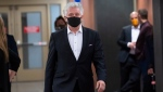 Just for Laughs founder Gilbert Rozon walks the hall of the courthouse as he arrives for the beginning of his sexual assault trial in Montreal on Tuesday, October 13, 2020. THE CANADIAN PRESS/Paul Chiasson