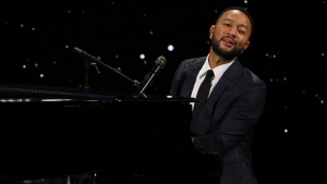 "John Legend performs live on stage at The Alliance for Children's Rights 28th Annual Dinner on March 5, 2020, in Beverly Hills, Calif. Legend dedicated his performance of ""Never Break"" at the Billboard Music Awards, aired Wednesday, Oct. 14, 2020, to his wife Chrissy Teigen, who recently announced she had a miscarriage. (Photo by Willy Sanjuan/Invision/AP, File)"