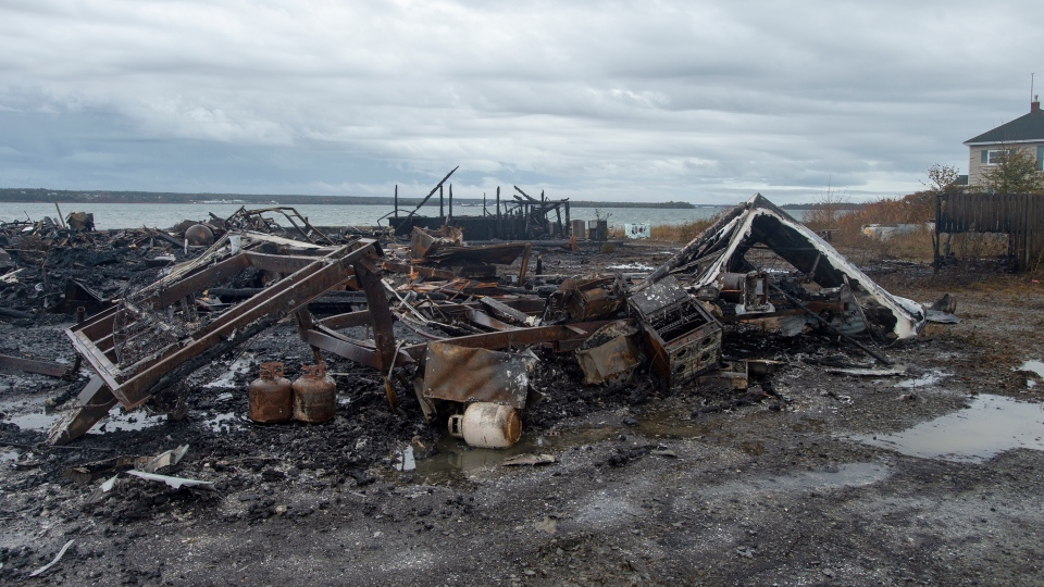 Debris from a burnt out fish plant is scattered along the shore in Middle West Pubnico, N.S. on Saturday, Oct. 17, 2020. A large fire destroyed a commercial building that was the scene of a confrontation earlier in the week between Indigenous and non-Indigenous fishermen.Tensions remain high over an Indigenous-led lobster fishery that has been the source of conflict. THE CANADIAN PRESS /Andrew Vaughan