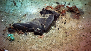 This 2004 image provided by the University of Rhode Island's Institute for Exploration and Center for Archaeological Oceanography and the National Oceanic and Atmospheric Administration's Office of Ocean Exploration shows the shoes of one of the possible victims of the Titanic disaster. A company's plan to retrieve the Titanic's radio has sparked a debate over whether the famous shipwreck still holds human remains.(Institute for Exploration and Center for Archaeological Oceanography/University of Rhode Island/NOAA Office of Ocean Exploration via AP)