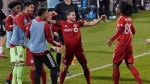 Toronto FC's Pablo Piatti, center, celebrates his goal with this team during the second half of an MLS soccer match against Atlanta United, Sunday, Oct. 18, 2020, in East Hartford, Conn. (AP Photo/Jessica Hill)