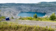 The open pit of the now closed Jeffrey mine is seen Wednesday, August 10, 2016 in Asbestos, Que. THE CANADIAN PRESS/Paul Chiasson