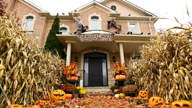 The front entrance to the Thornhill Woods Halloween haunted house is shown during the COVID-19 pandemic in Thornhill, Ont., on Monday, October 19, 2020. THE CANADIAN PRESS/Nathan Denette