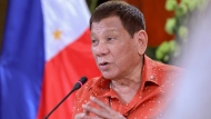 In this photo provided by the Malacanang Presidential Photographers Division, Philippine President Rodrigo Duterte speaks during a meeting at the Malacanang presidential palace in Manila, Philippines on Monday Oct. 19, 2020. The Philippine president has said he could be held responsible for the thousands of killings under his anti-drugs crackdown and was ready to face charges, except crimes against humanity, that could land him in jail. (Robinson Ninal Jr./Malacanang Presidential Photographers Division via AP)