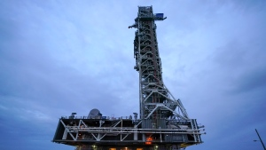 The mobile launcher atop crawler-transporter 2 moves to launch pad 39B for additional operations to the pad to conduct a timing demonstration of activities that occur late in the launch countdown in preparation for the Artemis I launch at the Kennedy Space Center, Tuesday, Oct. 20, 2020, in Cape Canaveral, Fla. The Artemis I rocket is expected to launch in November of 2021. (AP Photo/John Raoux)