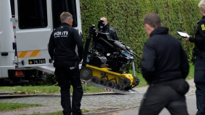 Police officers attend the scene after Peter Madsen was apprehended following a failed escape attempt in Albertslund, Denmark, Tuesday Oct. 20, 2020. The self-taught Danish engineer, who was convicted of torturing and murdering a Swedish journalist on his homemade submarine in 2017 before dismembering her body and dumping it at sea, on Tuesday was captured after attempted prison escape outside the suburban Copenhagen jail where he is serving life-time sentence. (Nils Meilvang/Ritzau Scanpix via AP)