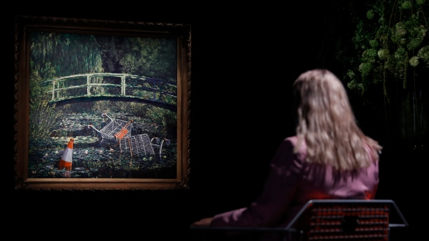 Banksy artwork sells for nearly $10 million at auction