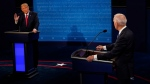 President Donald Trump answers a question as Democratic presidential candidate former Vice President Joe Biden listens during the second and final presidential debate Thursday, Oct. 22, 2020, at Belmont University in Nashville, Tenn. (AP Photo/Morry Gash, Pool)