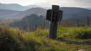 The tail of a multiple rocket 'Smerch' sticks out of the ground near the town of Martuni, the separatist region of Nagorno-Karabakh, Friday, Oct. 23, 2020. Heavy fighting over Nagorno-Karabakh is continuing with Armenia and Azerbaijan trading blame for new attacks. Two Russia-brokered cease-fires collapsed instantly after taking effect, and the warring parties have continued to exchange blows with heavy artillery, rockets and drones. (AP Photo)